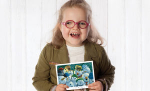 Image a happy girl hold a Courage Art card